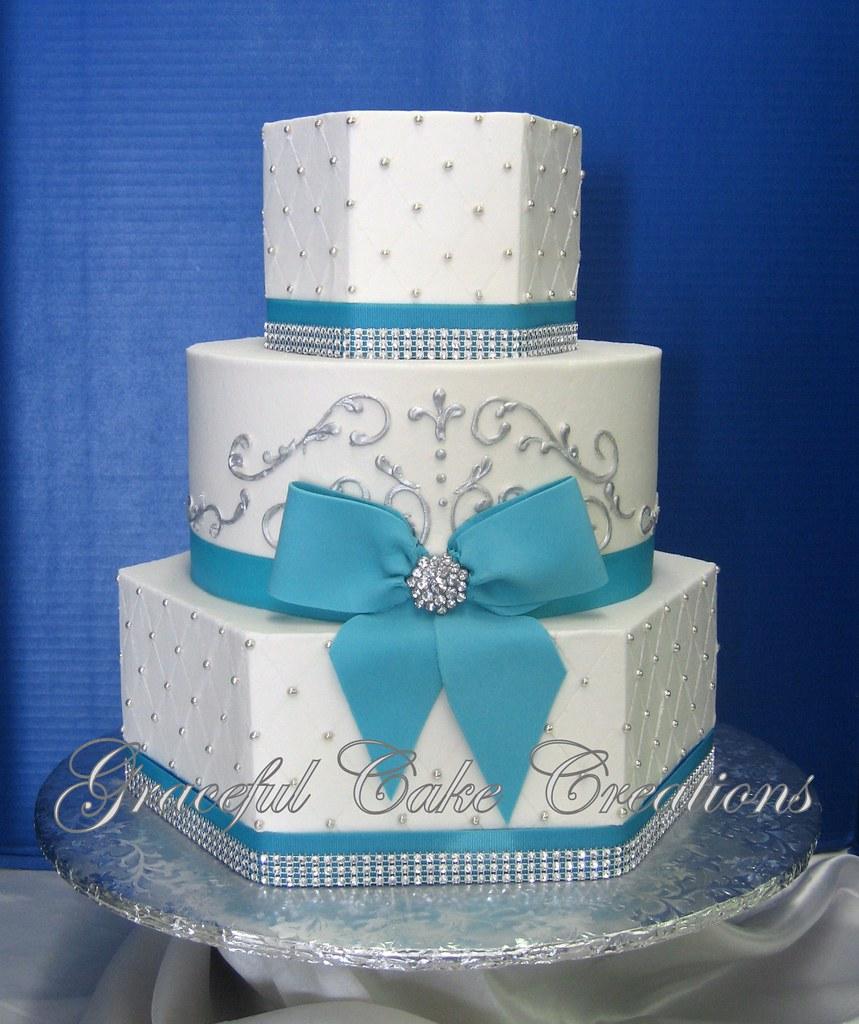 Elegant White Butter Cream Wedding Cake with Tiffany Blue