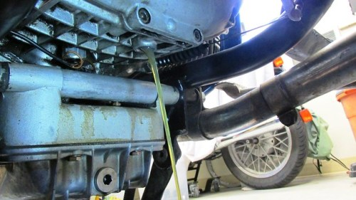 Draining Transmission Gear Lube Into Clean Container