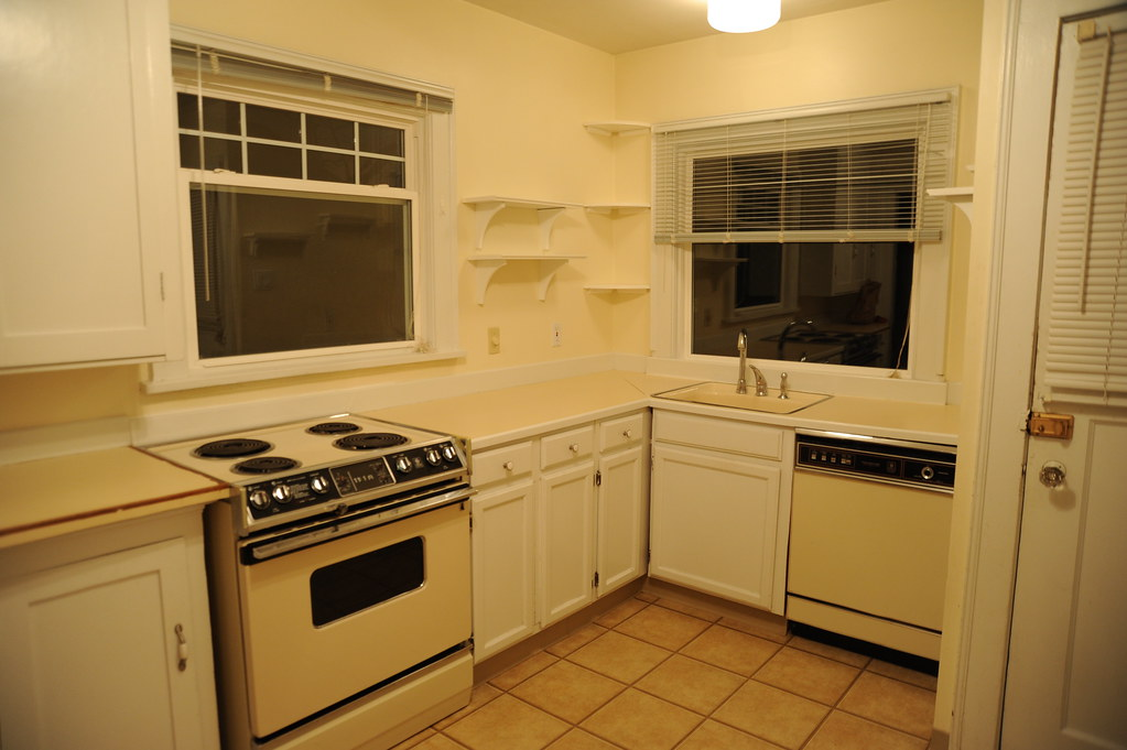 white kitchen appliances moen faucets warranty rental house kitchen, yellow walls, fixtures and ap ...