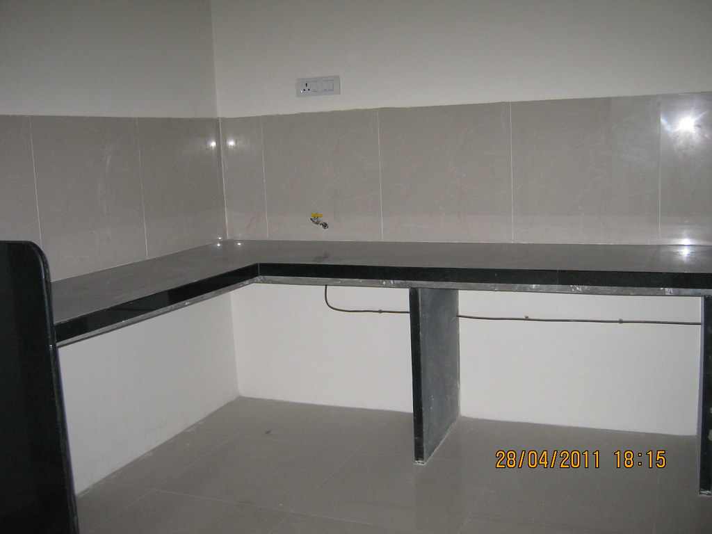 L Shaped Kitchen Platform With Jet Black Granite Top And P