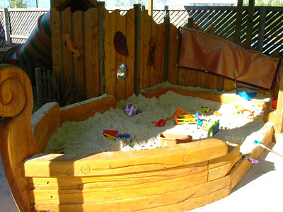 Boat Shaped Sandpit  Sand play in a boat shaped canopied