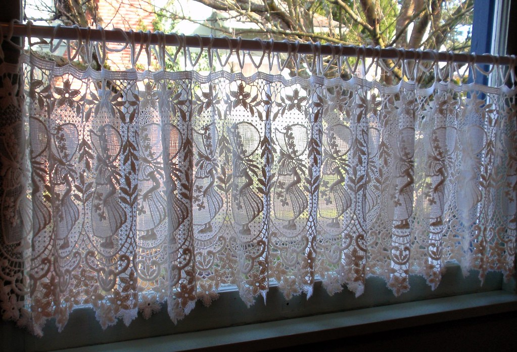 Dutch lace curtains in dining room window  These were my