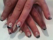 black tips and white swirl nail
