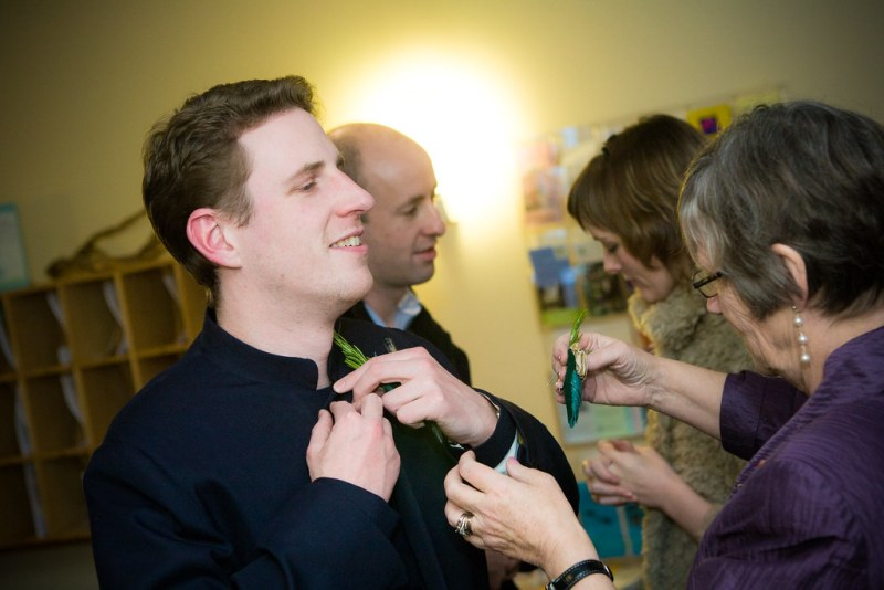 Groom gets his hand sewn boutonniere