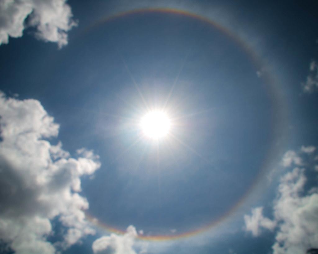 Rainbow Sun While Beneith The Sacred Buddhist Waterfall
