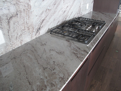stone kitchen backsplash white shaker cabinets granite slab counter tops with full height backspl ...