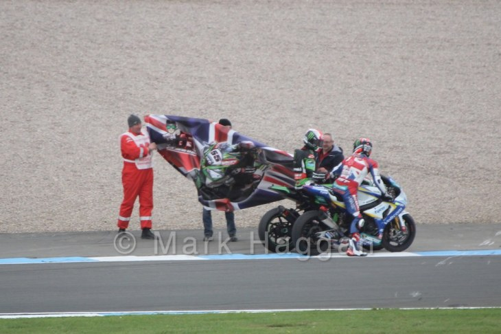 Jonathan Rea picks up a supporter's flag after World Superbikes Race 2 at Donington, May 2015