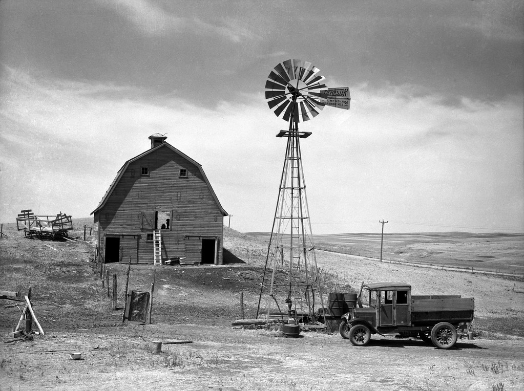 Rothstein, Arthur, photographer. Empty barns and idle trucks are found throughout the drought area. Beach, North Dakota. July, 1936.