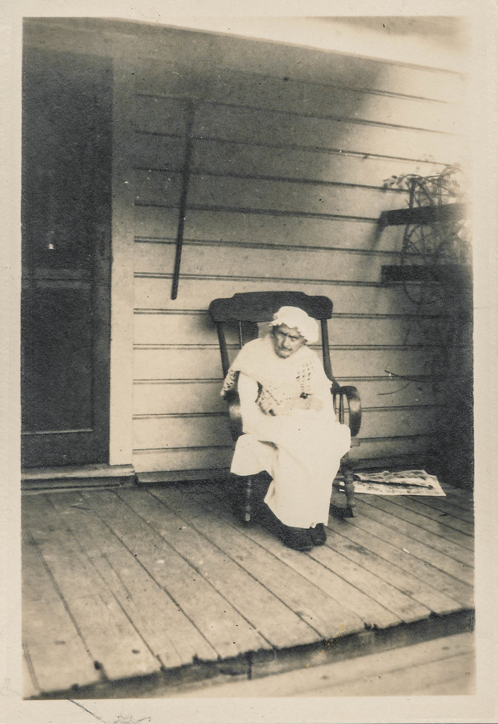 Tiny old woman sits on her rocking chair on the porch  Flickr