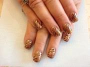 acrylic nails with bronze polish
