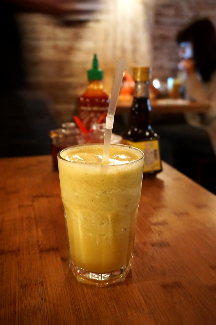 Glass of coconut, pineapple and apple juice