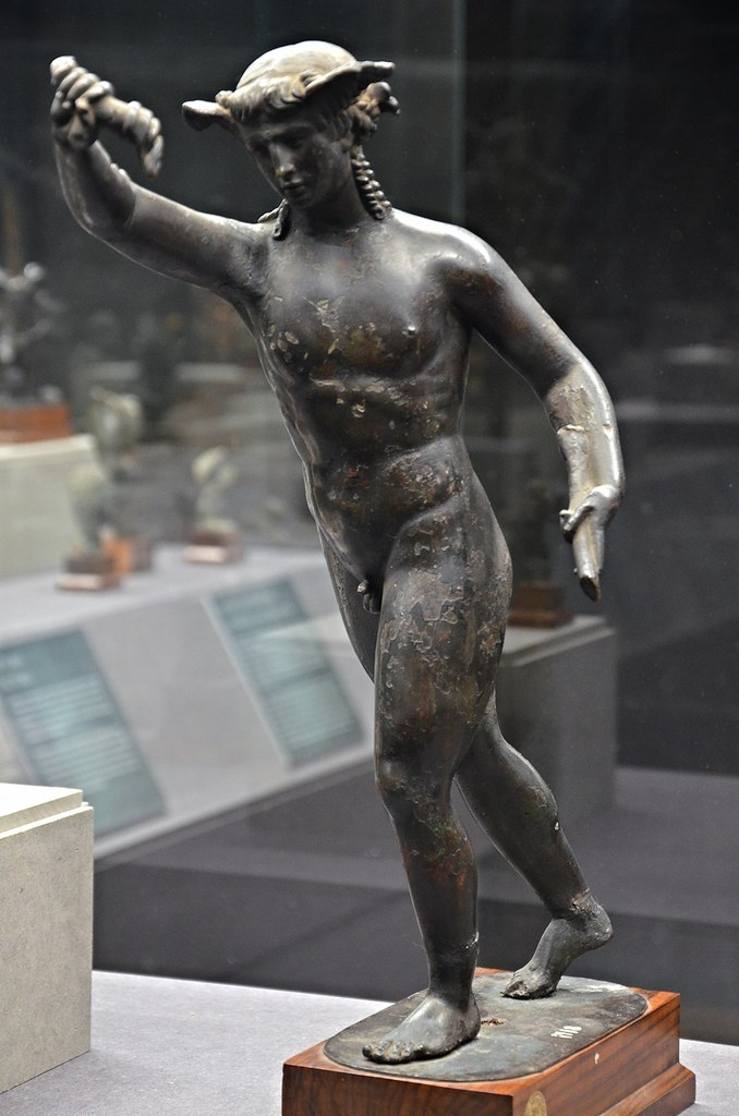 Bronze statuette of Hypnos with a crown of poppies and win