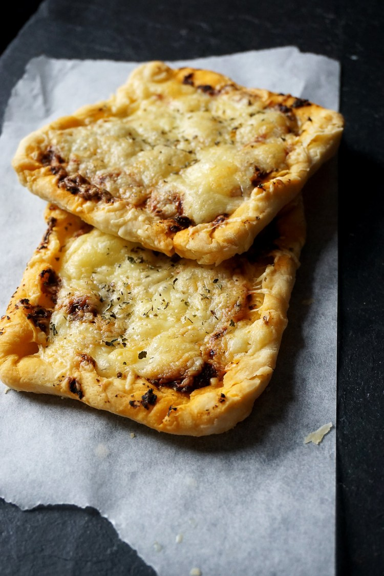 Gluten free pastry pizza slices made with Genius gluten free puff pastry