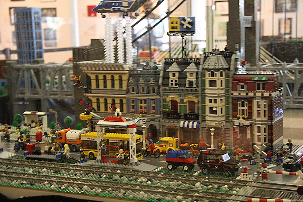 LEGO Victorian houses and helicoper near the train tracks
