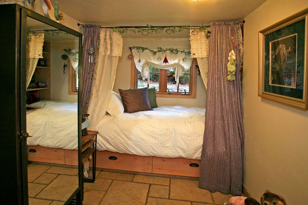 Storybook Stone Cottage  Main floor bedroom  Heather