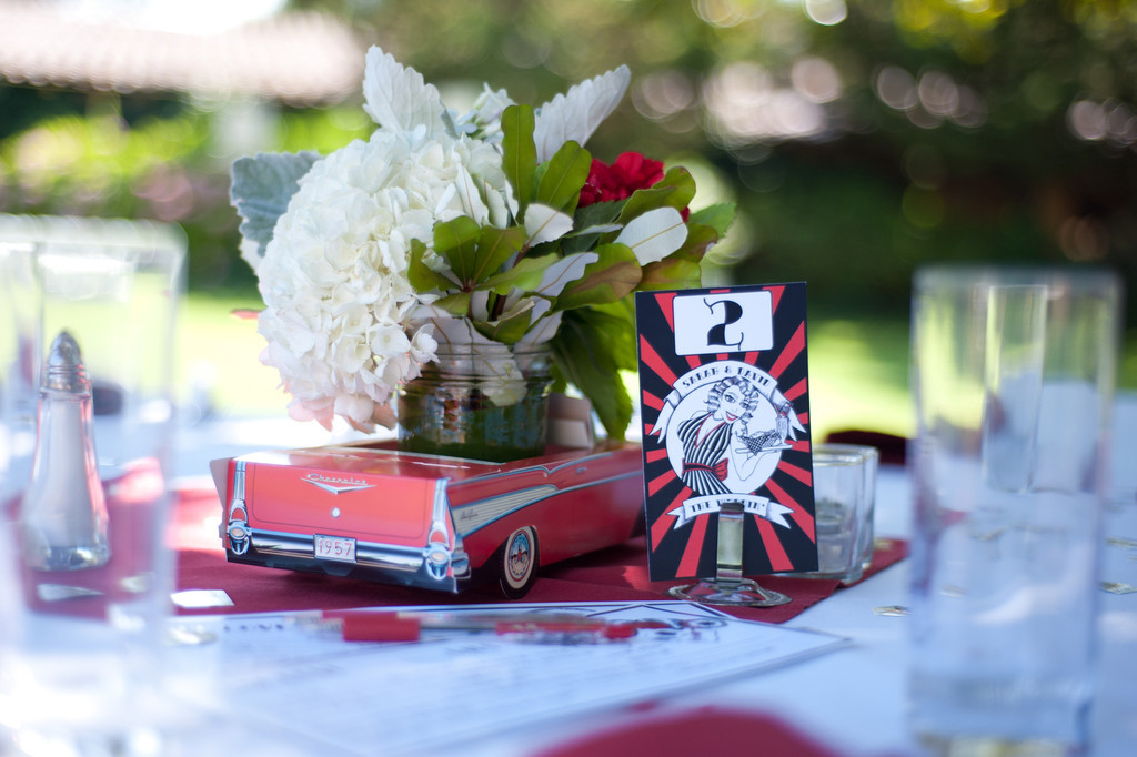 Centerpieces  Retro paper car with flower filled mason