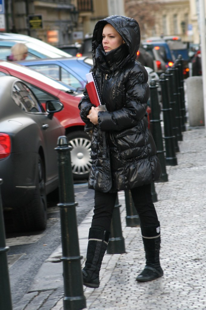 Going to work in shiny downjacket hood up in cold Prague m