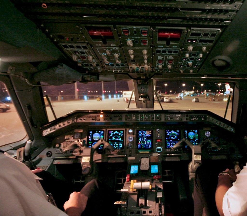 Cockpit Of Erj 145 View On The Night Apron Of Munich