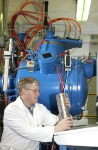 Plasma furnace   Technician Arne Swanson holds an ingot of ...