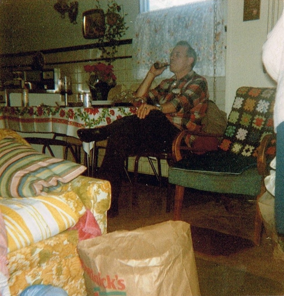 sitting chairs for living room white chair covers with royal blue sashes having a smoke | that's my dad smoking his pipe in the kitch… flickr
