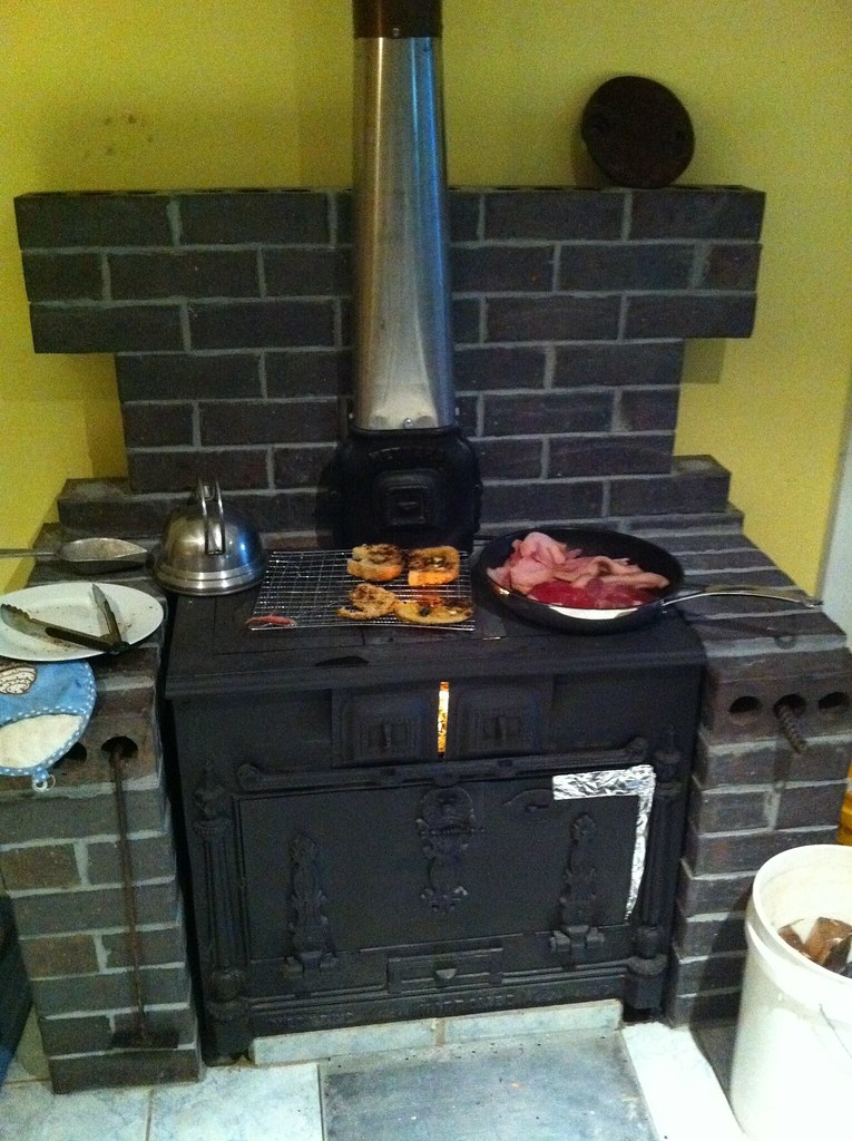Dinner on the old wood stove reinstalled in the new house