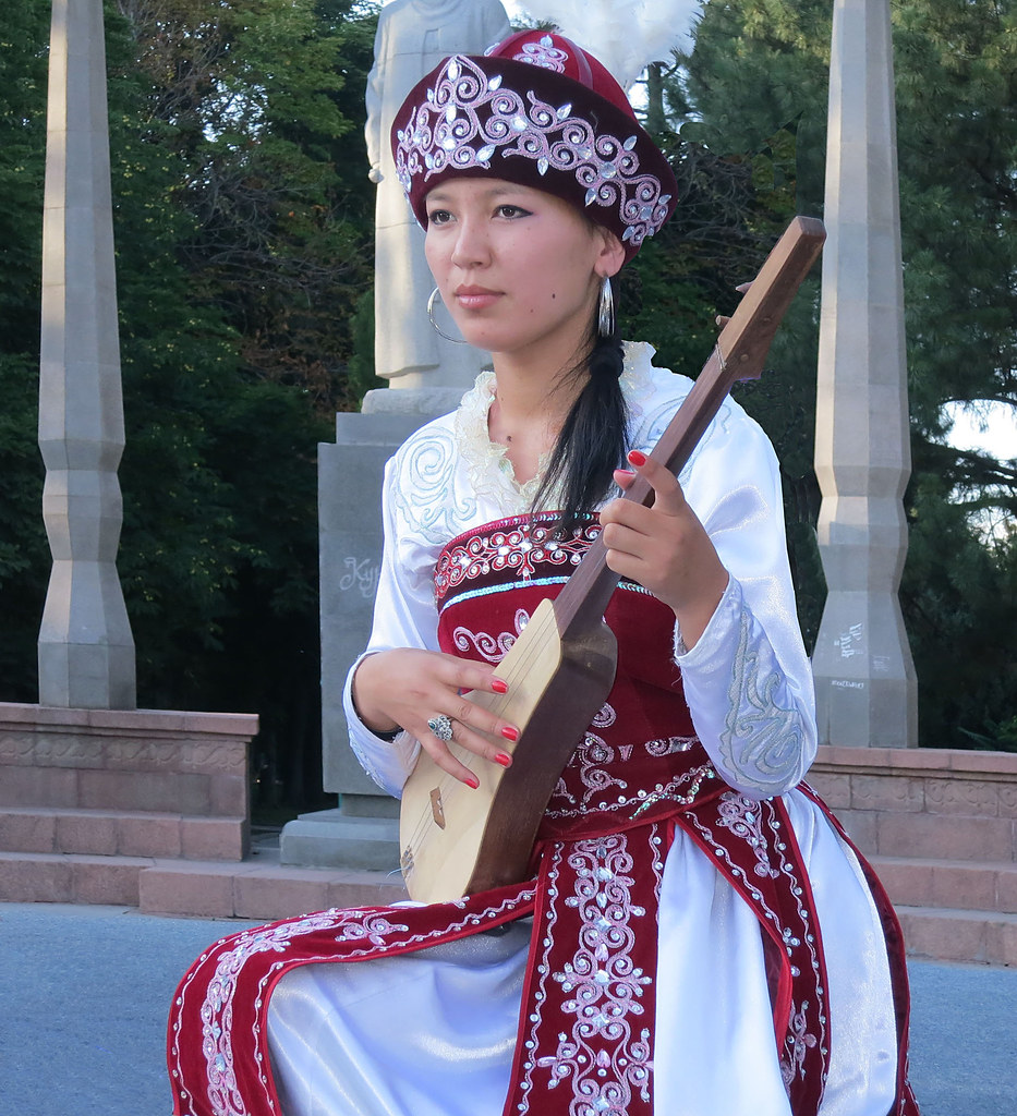 A Kyrgyz Girl Playing The Stringed Intrument Called Komus