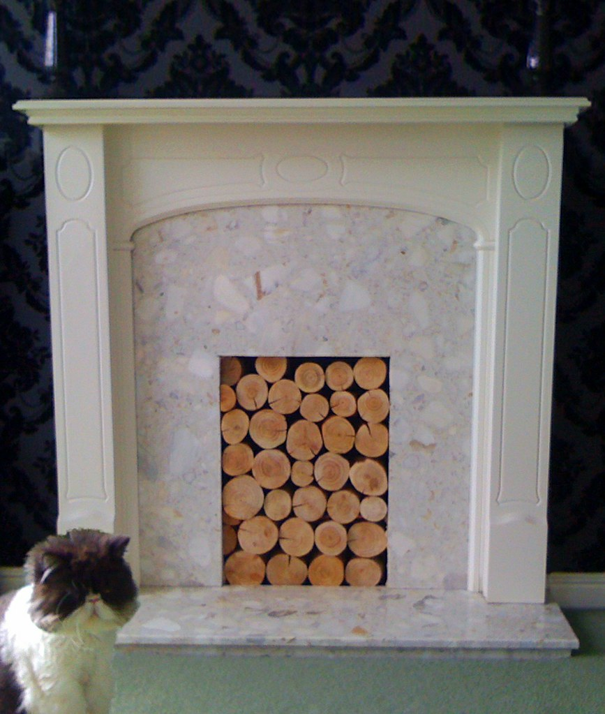 Decorative logs in feature fireplace