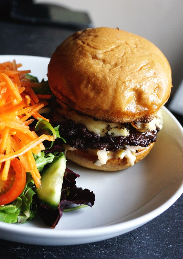 Gluten free cheeseburgers made with Just: Gluten Free Bakery brioche buns, edam cheese, fried onions and homemade patties and burger sauce.