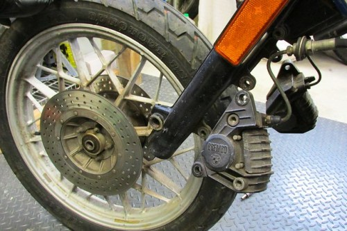 Wheel Removed and Calipers Hanging on Fork Brace Bracket