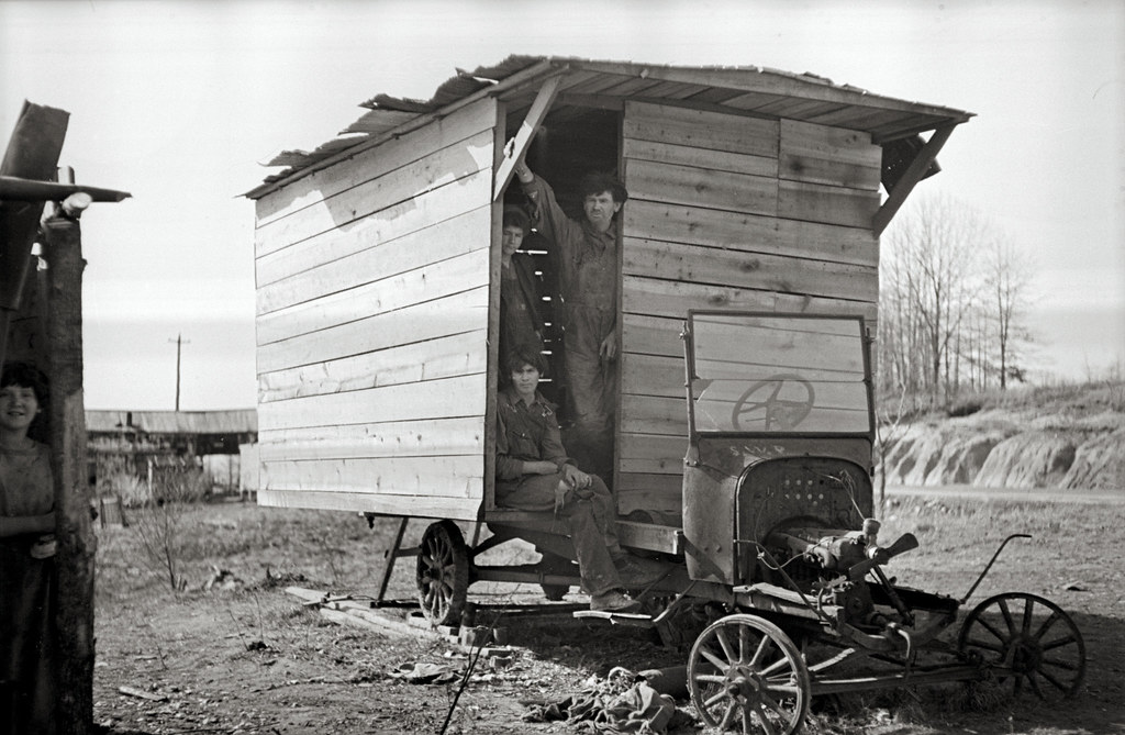 One-room hut housing family of nine built over chassis of abandoned Ford in open field between Camden and Bruceton, Tennessee, near Tennessee River.