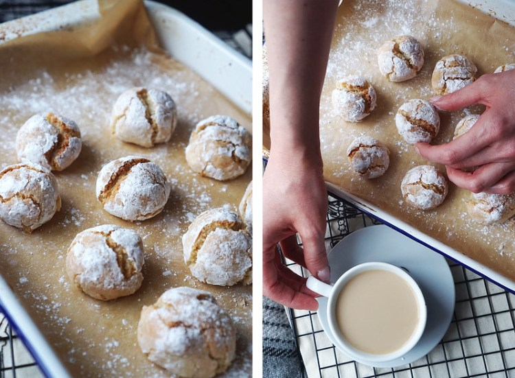 Homemade gluten free amaretti biscuits rolled in icing sugar
