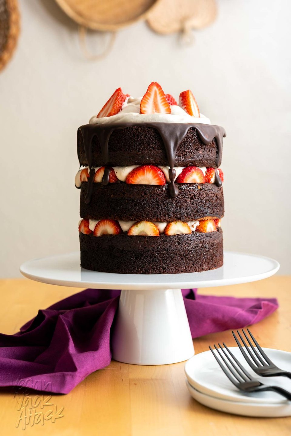 Decadent, dreamy, and absolutely delicious! This vegan chocolate layer cake is perfect for sharing with loved ones, on special occasions. #vegan #valentinesday #chocolatecake #veganyackattack