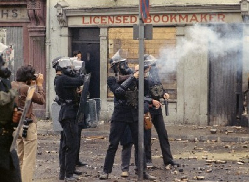 Riot police wearing helmets and gas masks during disturbances on 13 August 1969.