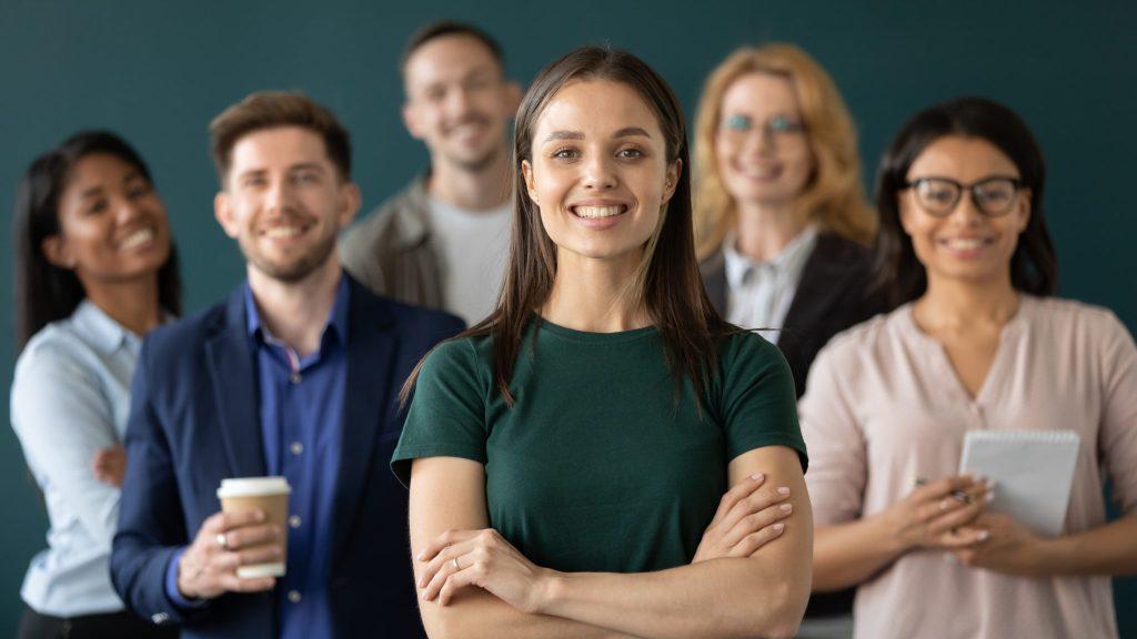happy businesswoman hands crossed posture