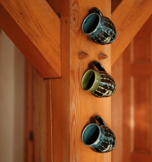 Mugs at home by Polly Wellford
