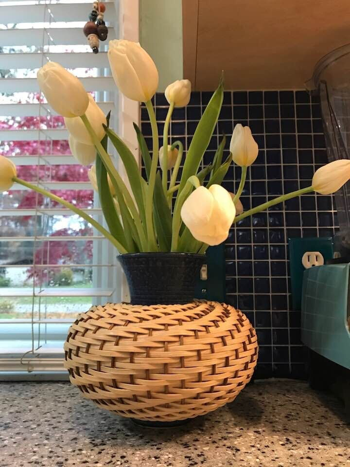 White Tulips in a Basket and Clay Vase