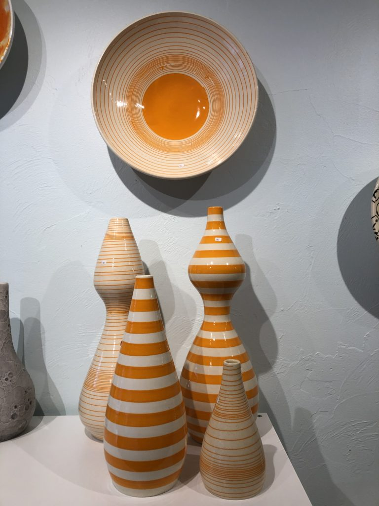 Orange ceramic vessels by Jeff Blandford