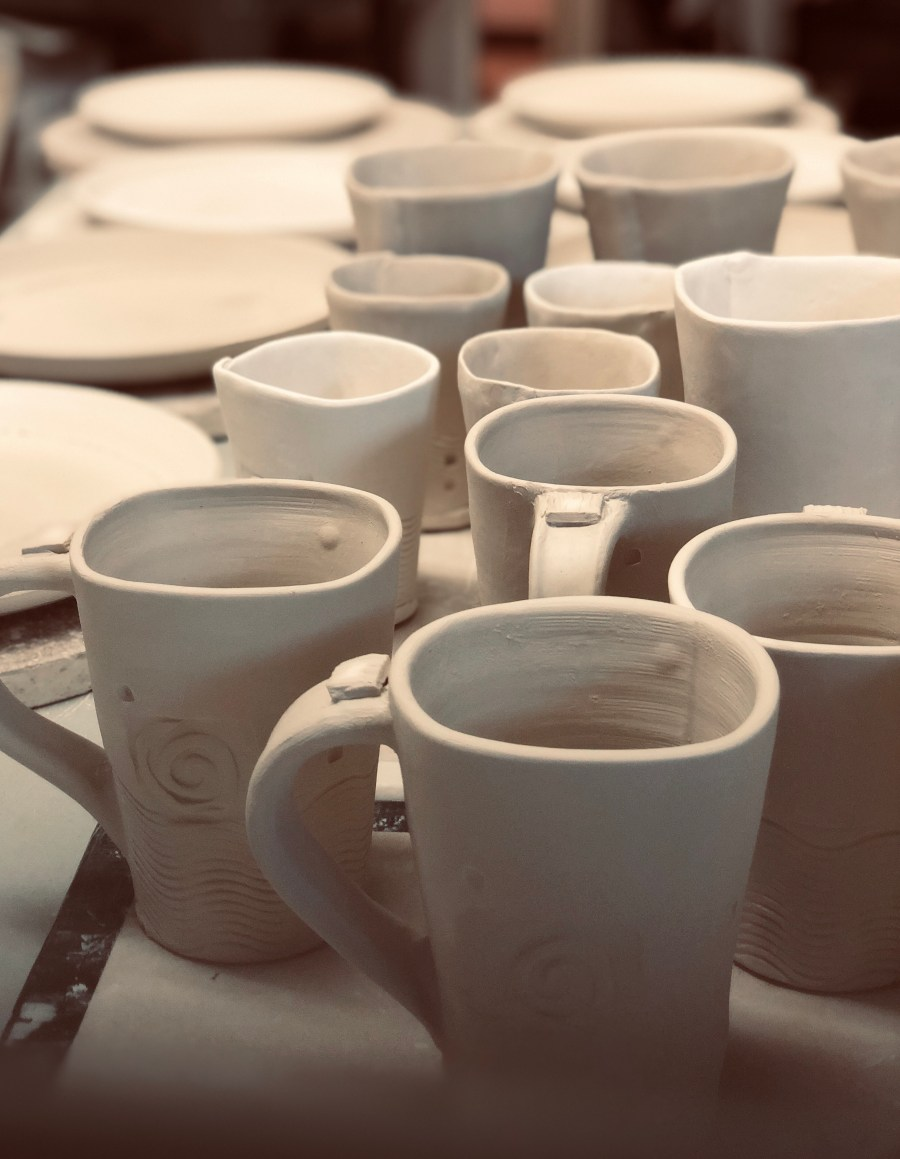 Mugs and plates in Cyndi casemier's studio