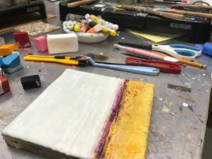 Ronna Alexander working on an encaustic painting