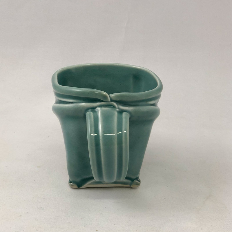 Handle view of softly squared porcelain mug by Marion Angelica