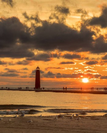 photograph of grand haven lighthouse and pier, orange sky