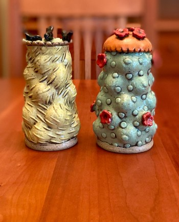 larger salt & pepper shakers with flowers and a raven
