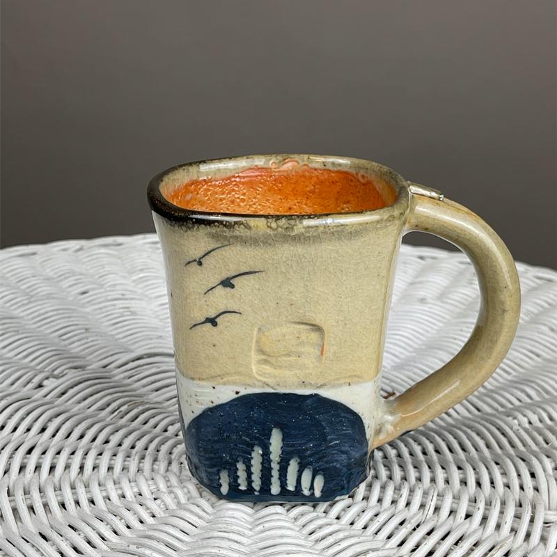 Handmade ceramic mug by cyndi CAsemier with seagulls and Lake Michigan beach sand