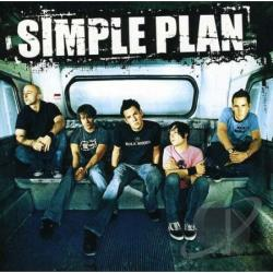 "Jeff Stinco, Sebastian Lefebvre, Pierre Bouvier, David Desrosiers, and Chuck Comeau of Simple Plan on a bus. The words ""Simple Plan""are at the top in white letters."