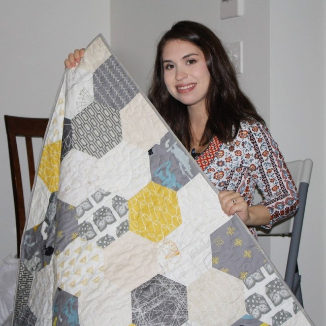 Chelsea and her quilt