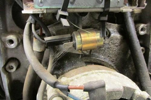 Condenser Mounts Using Bracket Around It. Note Cob Web :-)