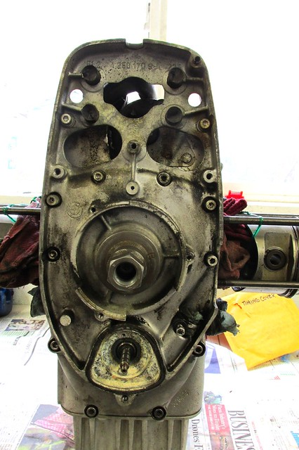 Timing Chest Cover Exposed with Cover Puller on Crankshaft Nose