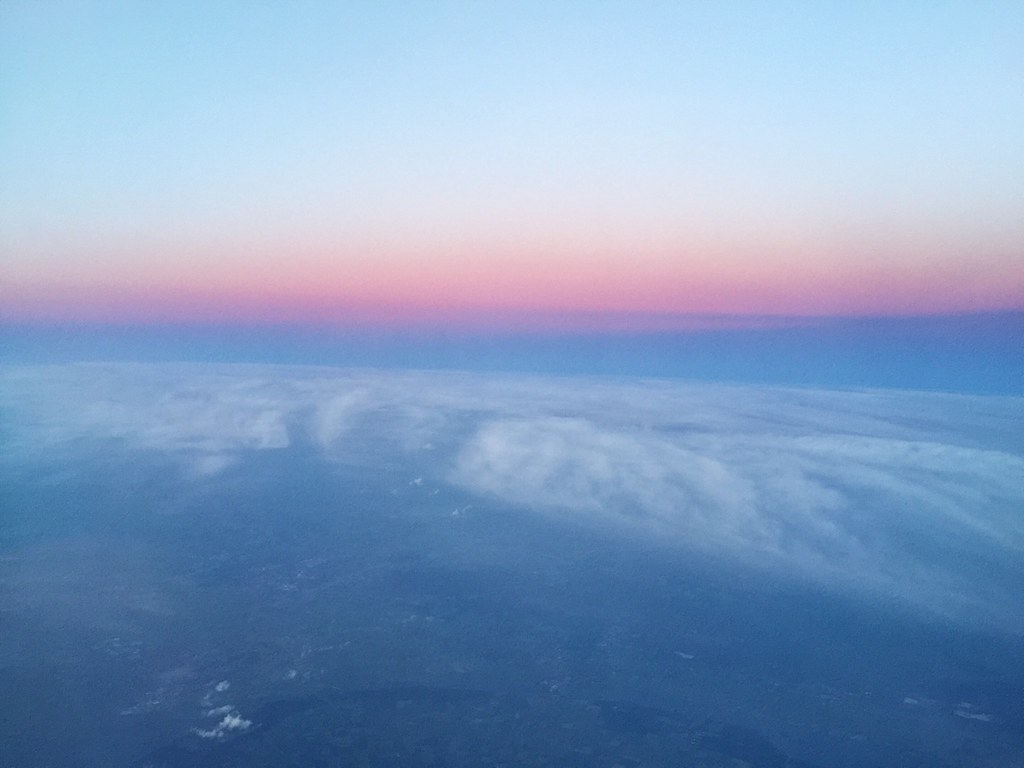 airplane flying sunset