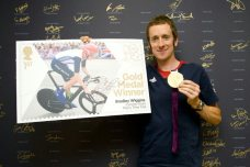 Bradley with his Gold Medal and enlarged stamp