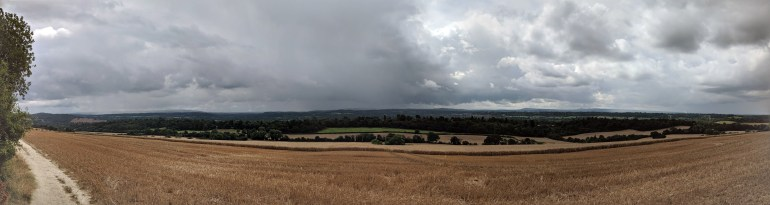 Rain in the distance, from the Hogs Back. Scattered showers all around, luckily we missed them all on the walk.